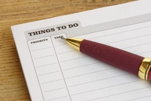 Things To Do list with a pen on a desk.Business concept.