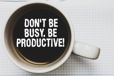 clarity and productivity Coffee cup saying: Don't be busy. Be productive.