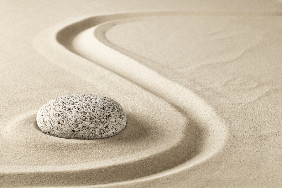 time block. rock in sand.