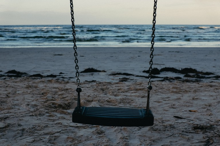 ability to play. empty swing on a beach.